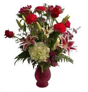 Vase of roses, lilies and hydrangeas